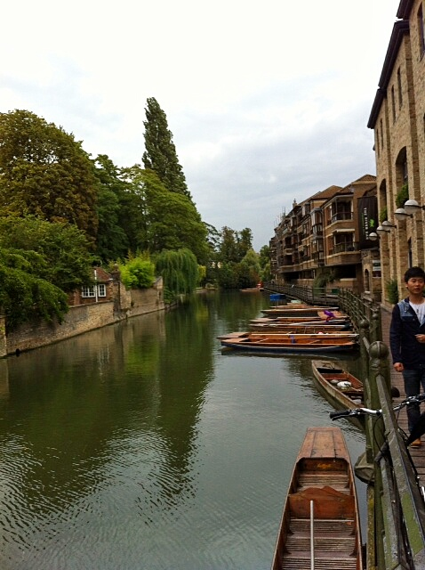 """Punting"" is a special type of wooden-boat which glides down the canal"