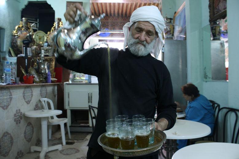 Mr. Berrada Ali Gerant pouring the group some mint tea.