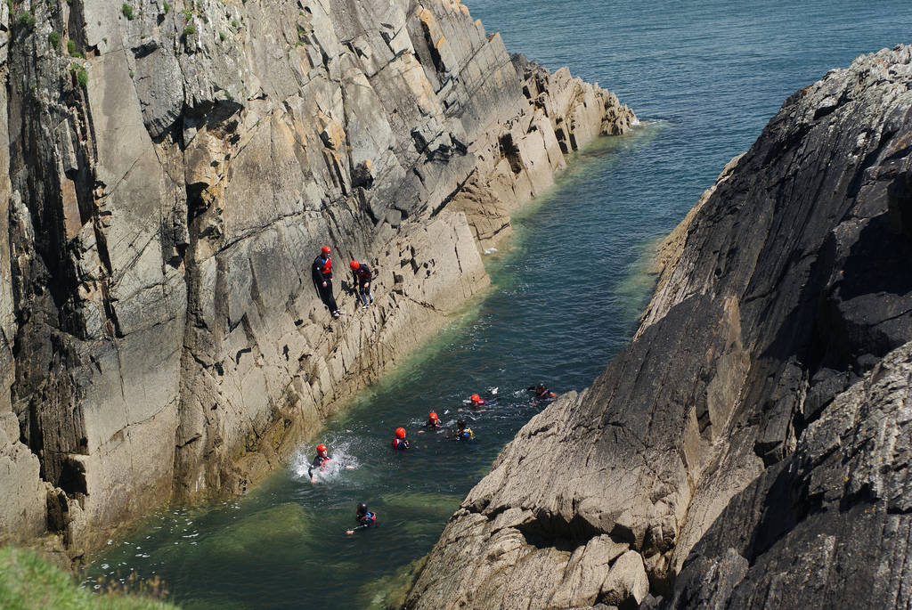 Coasteering Around the Cliffs Near St Davids, UK